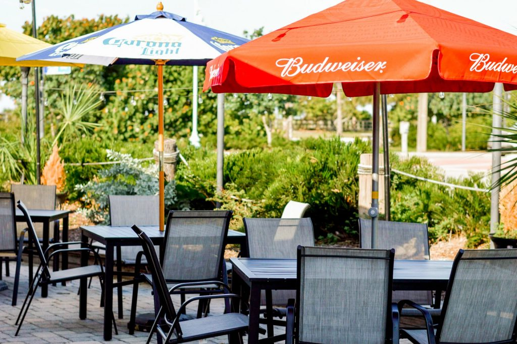 Tables with colorful beer brand umbrellas