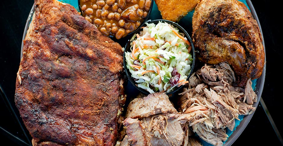 Ribs, Pulled Pork, quarter chicken, black beans, corn bread, coleslaw