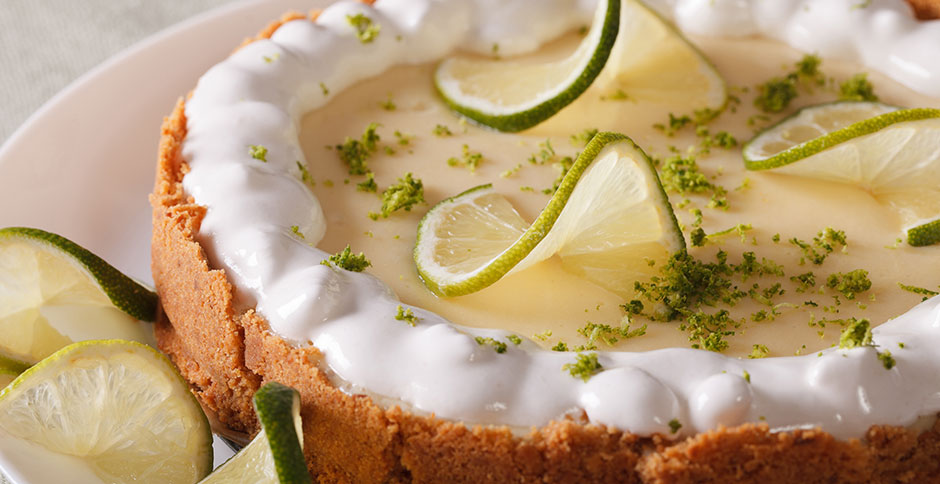 Key Lime pie garnished with limes amd whipped cream