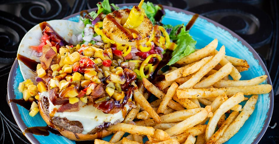 fries and burger with cheese , bacon, pineapple, mango salsa, banana peppers, pepperoncinis and red onions